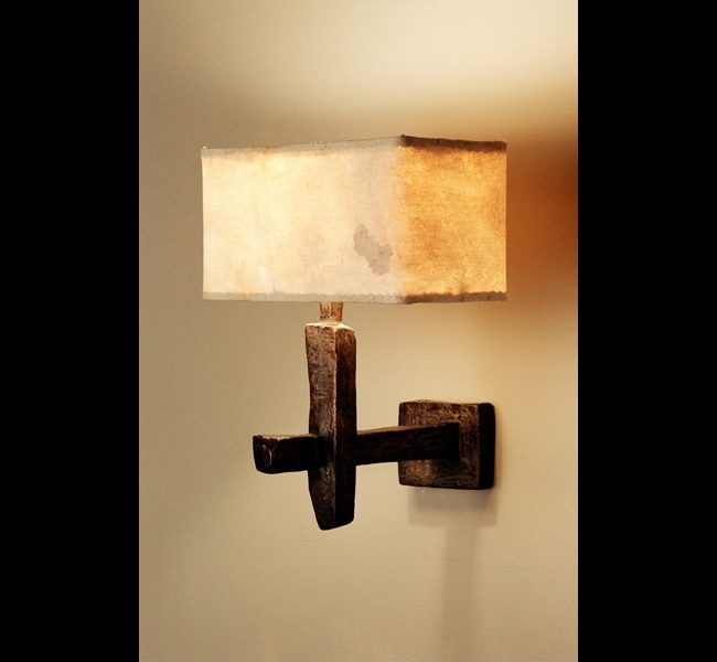 Sculptural bronze wall lamp with eucalyptus paper lampshade made by Hannah Woodhouse.