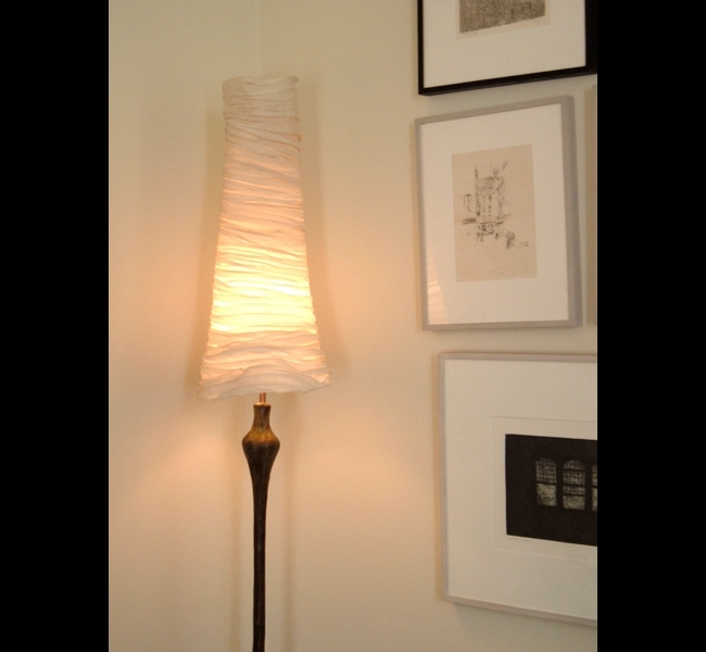 Tall and elegant Proud Woman II bronze floor lamp with layered and draped muslin conical lampshade made by sculptress Hannah Woodhouse.