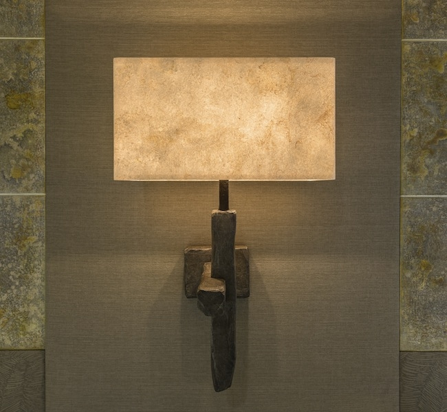 Wall Sconce in carved hard wood, by Hannah Woodhouse, bronze finish wall sconce, for super yacht Inukshuk